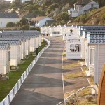 View along caravans at Porth Beach holiday park in Newquay